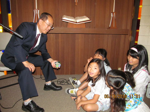Pastor Ohgueon Paul Kwon delievering a children sermon on Father's Day Sunday.